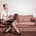 12596144-business-woman-using-computer-internet-home-technology-vintage-photo